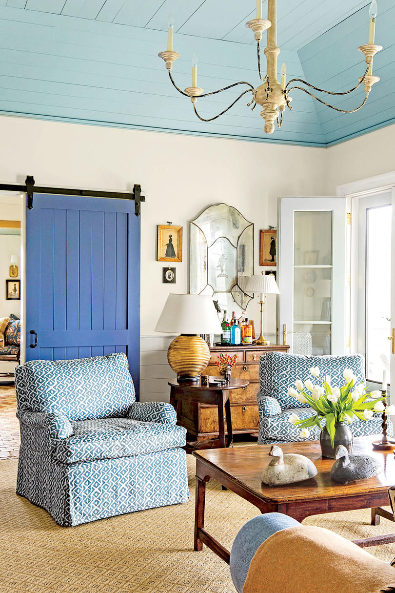 Living Room with Blue Barn Door