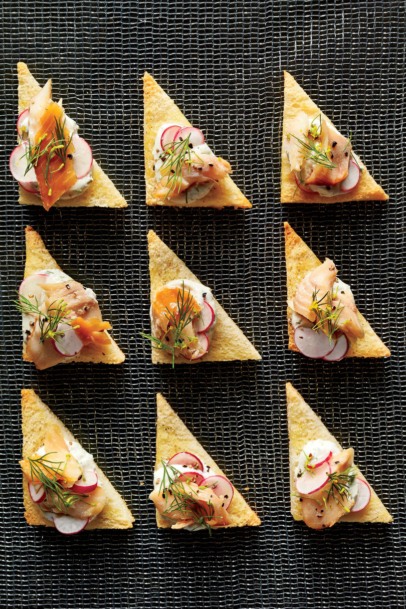 Best party appetizers and recipes southern living smoked trout crostini with radishes and dill cream forumfinder Gallery
