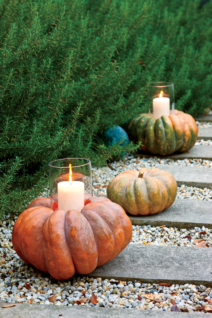 33 halloween pumpkin carving ideas southern living for Simple pumpkin centerpieces