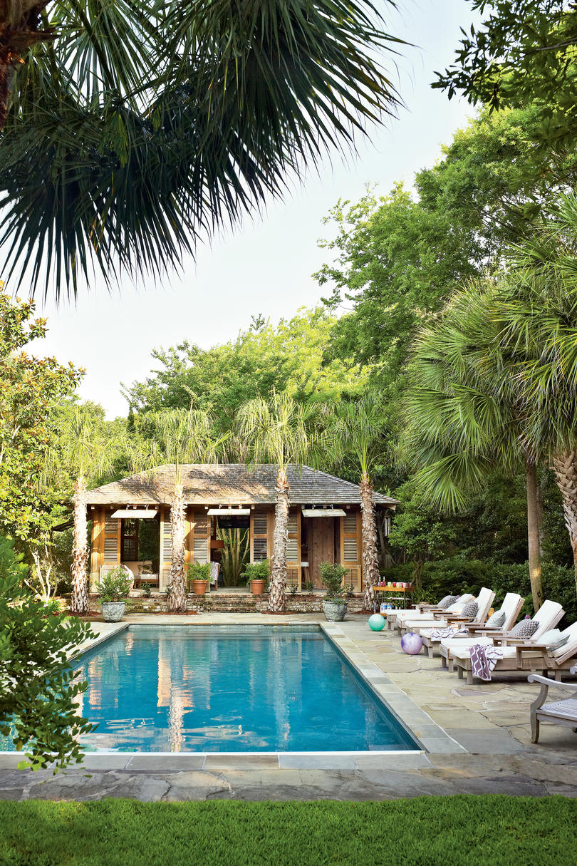 Tropical style pool house southern living for Pool garden house