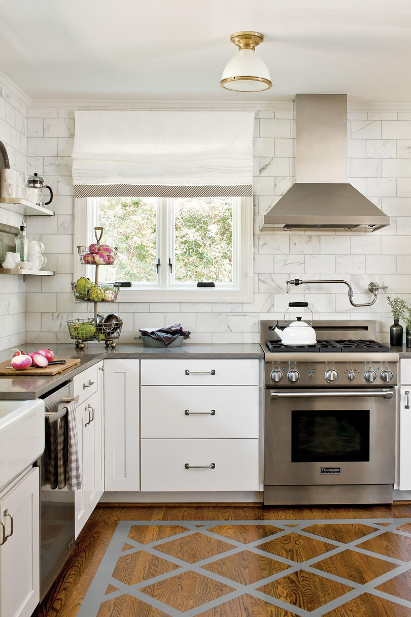 Crisp classic white kitchen cabinets southern living for Simple white kitchen designs