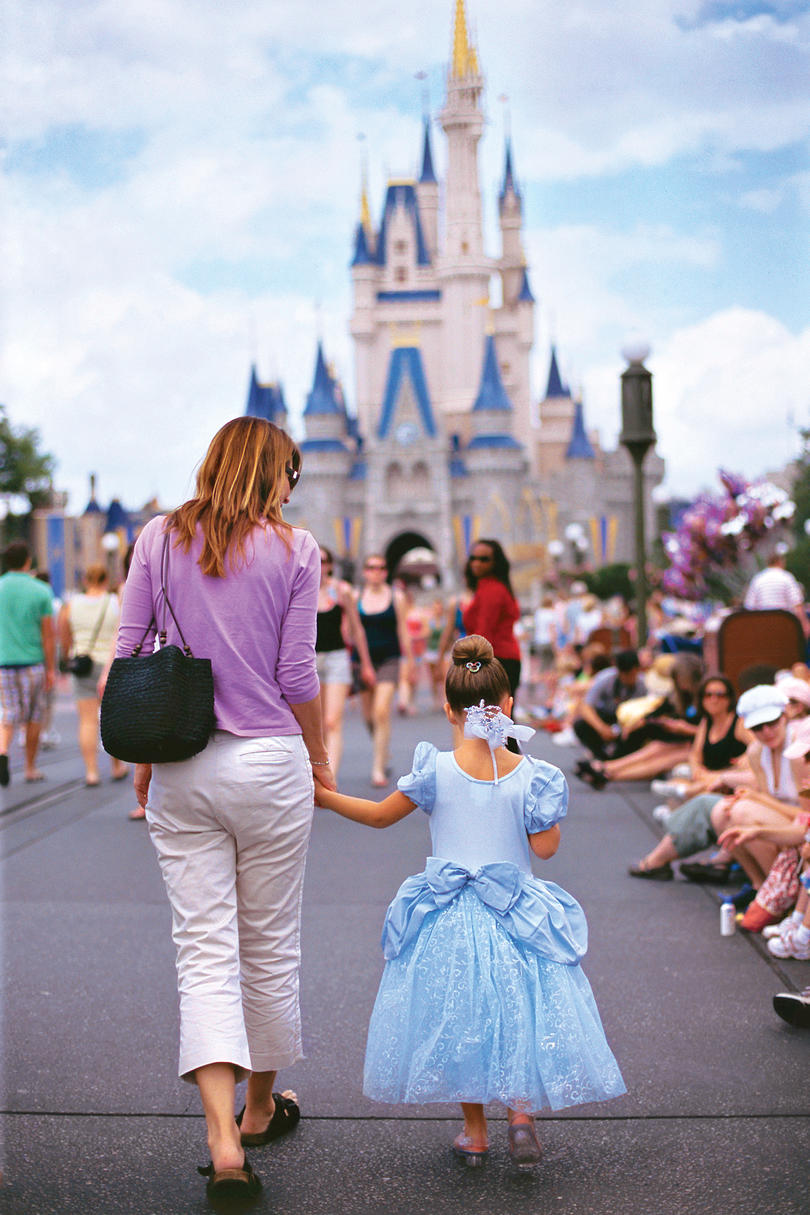 Girl And Mother Walking Toward Disney Castle