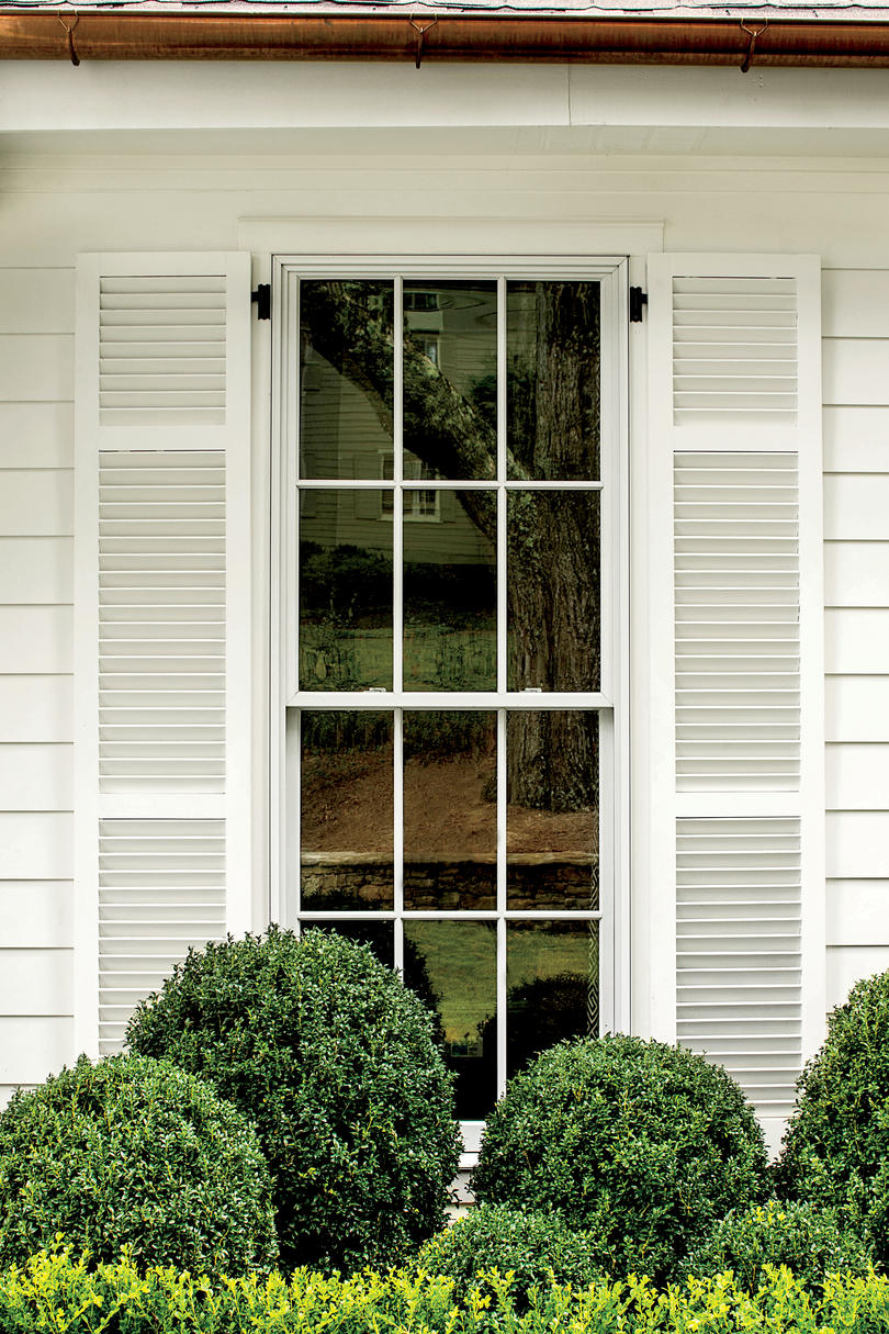 fake exterior house windows. shutters and siding in benjamin moore swiss coffee fake exterior house windows