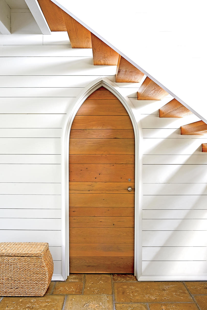 Gothic Door Surrounded by White Shiplap