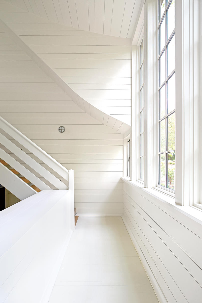 White Sweeping Shiplap Staircase