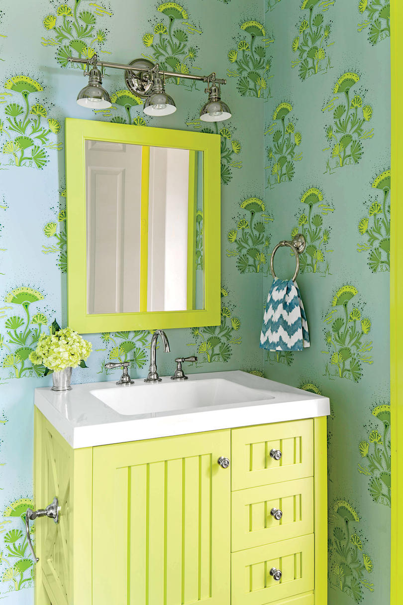 green and blue bathroom with wallpaper