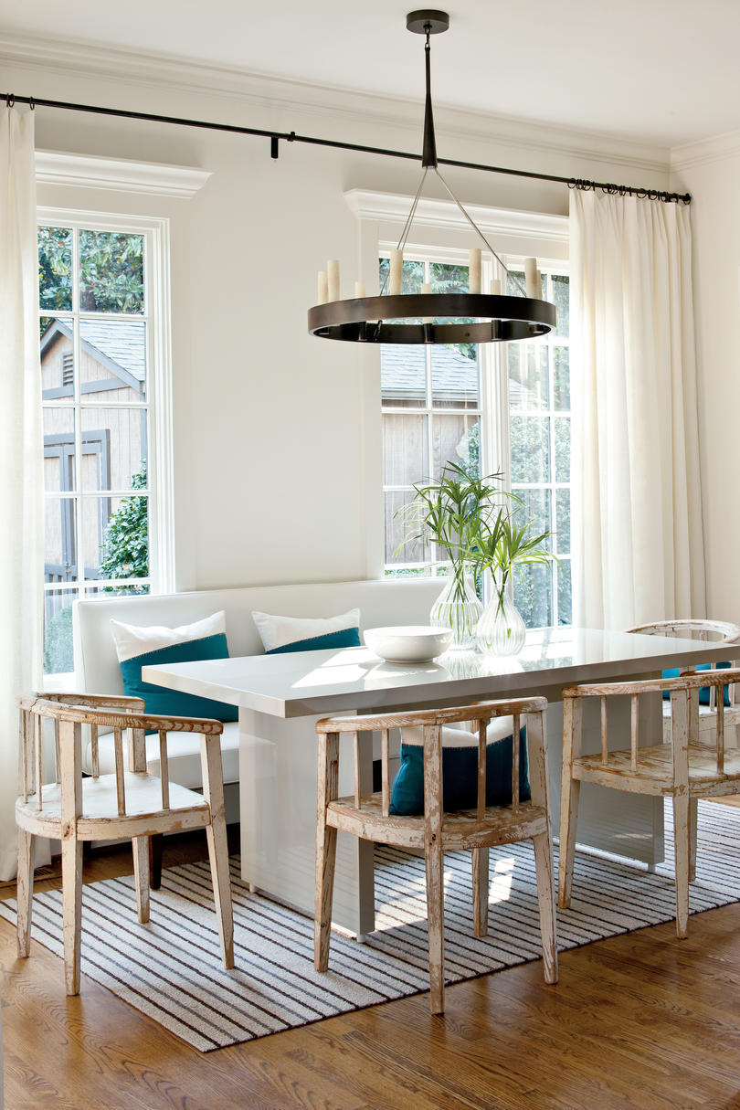 Airy Breakfast Room with Teal Accents