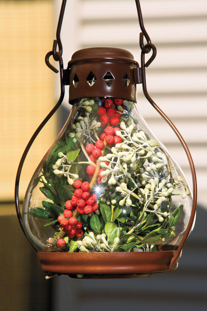 Glass Hanging Light Filled with Berries and Grennery for Christmas