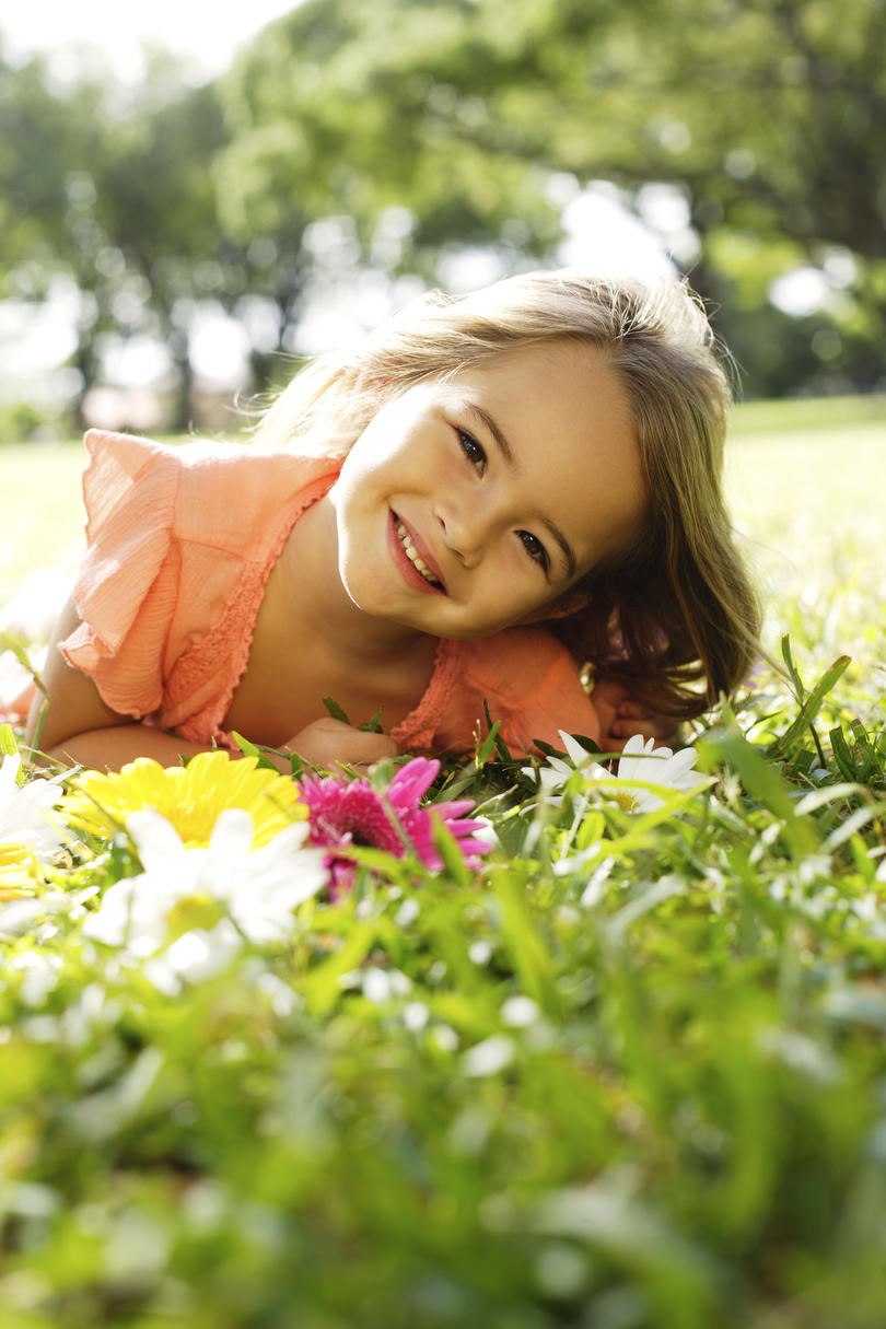 Girl with Flowers on Grass