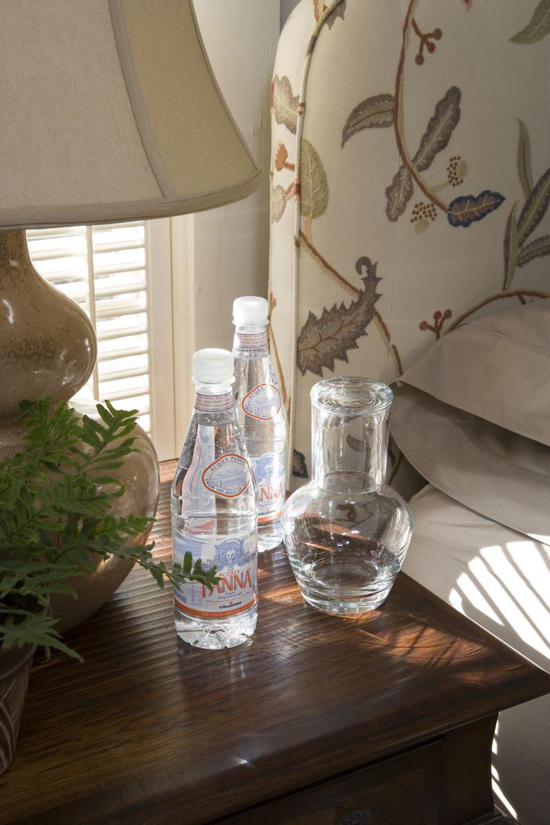 Bottles of water on bedside table