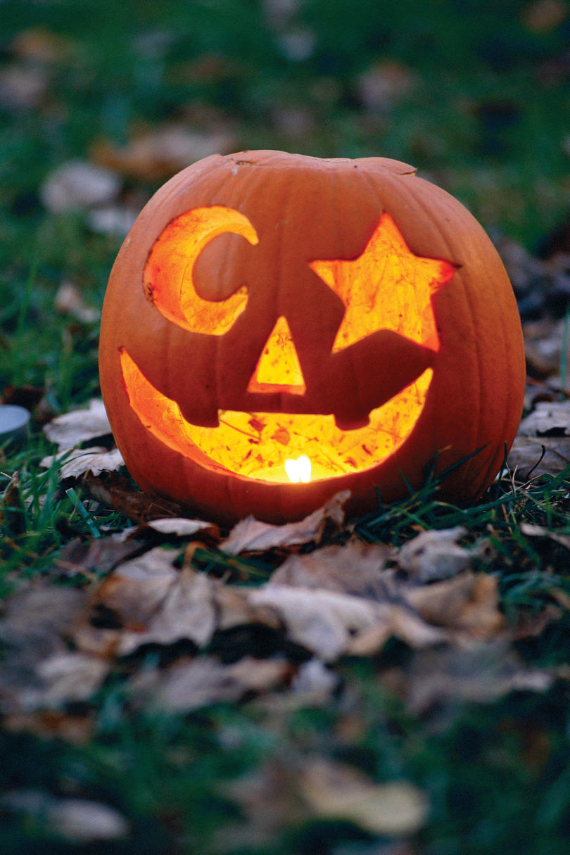 33 halloween pumpkin carving ideas southern living for Simple pumpkin stencils