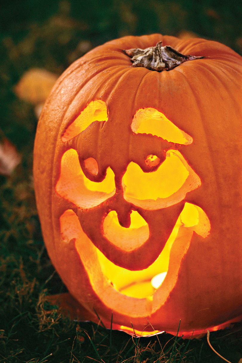 33 halloween pumpkin carving ideas southern living for Different pumpkin designs