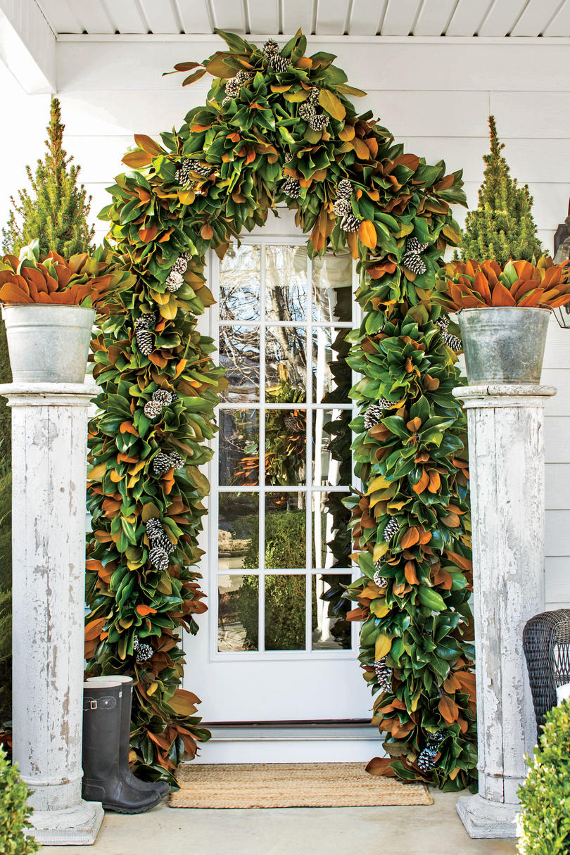 10 ways to decorate with magnolia this christmas southern living frame the front door with magnolia rubansaba