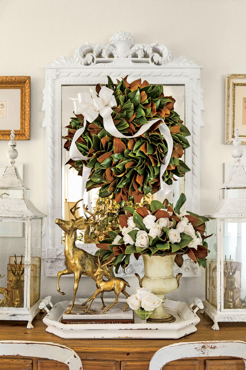 festive christmas wreath ideas southern living magnolia wreath on mirror with bow