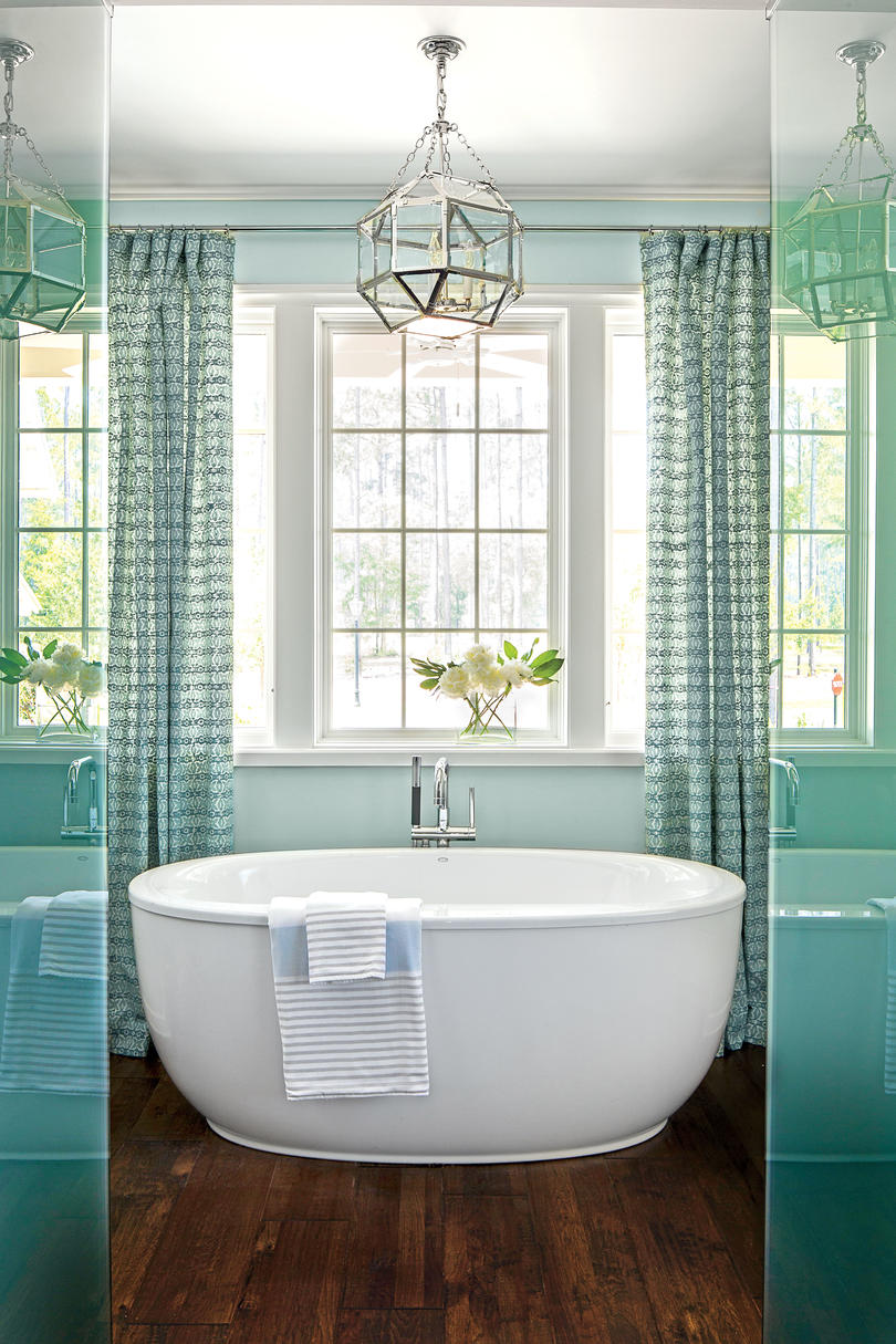 The 12 most relaxing bathtubs southern living - Small bathroom with tub ...