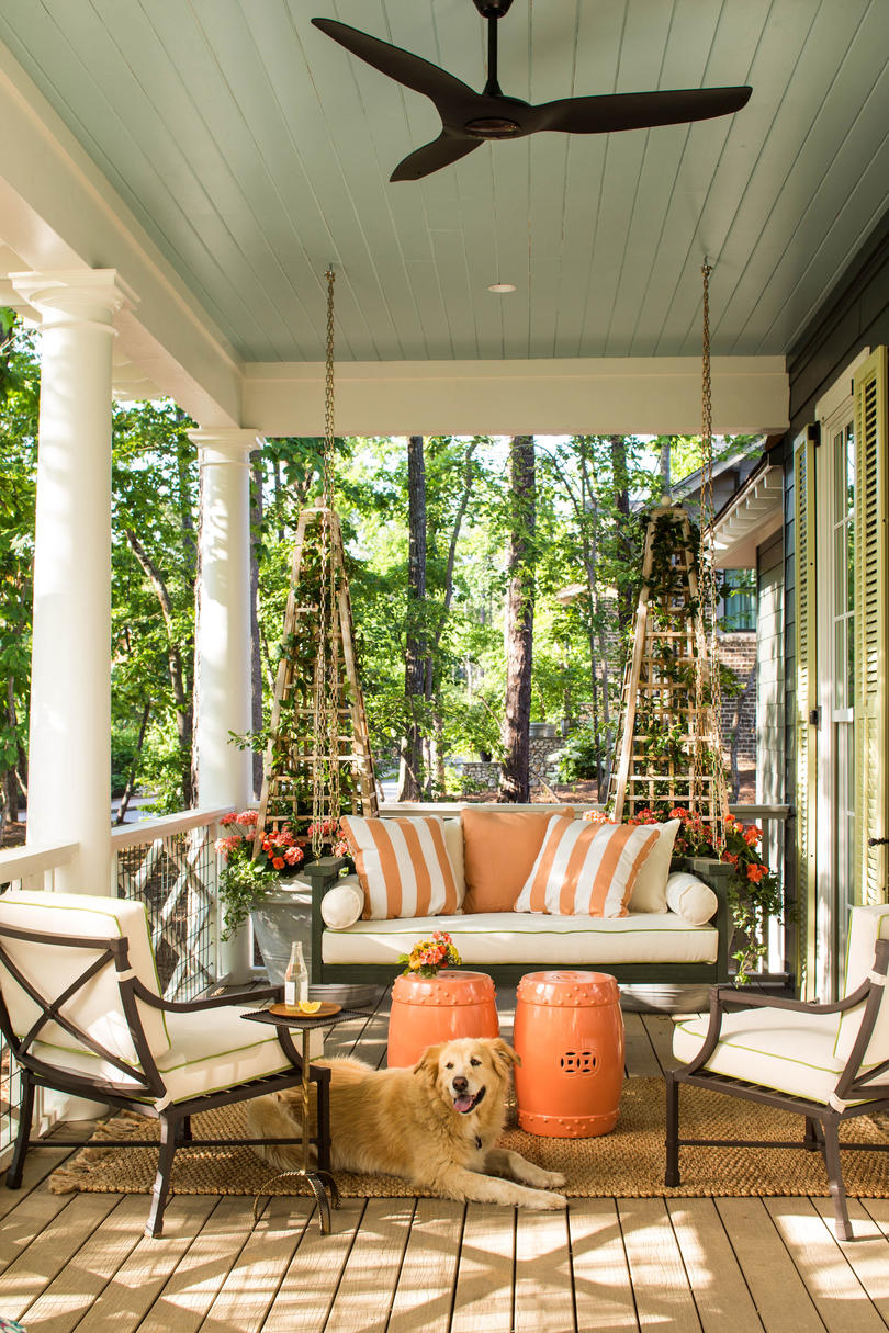 Side Porch with Swing and Orange Accents
