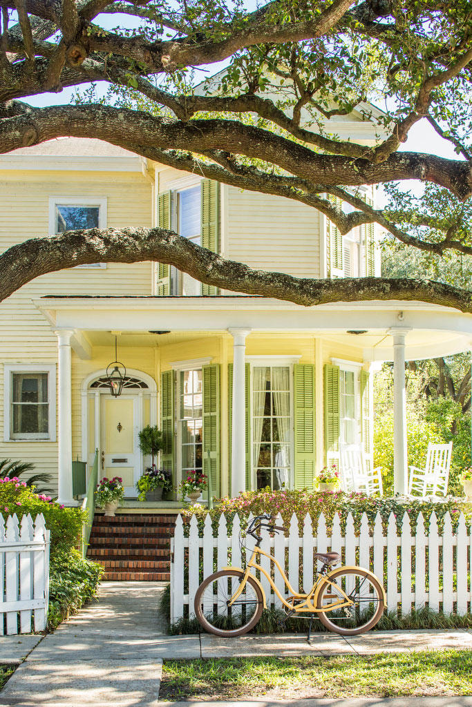 Yellow House with White Picket Fence