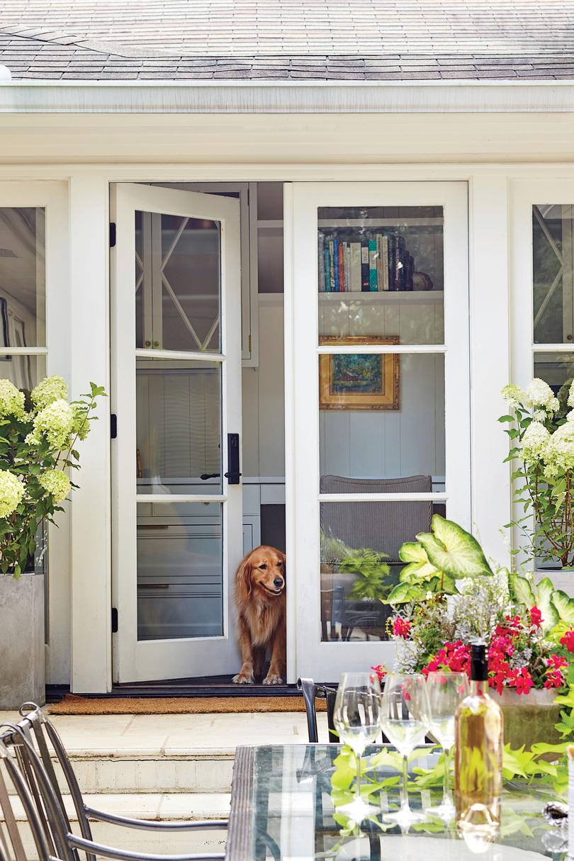 A dramatic ranch house renovation southern living for Patio doors for front of house