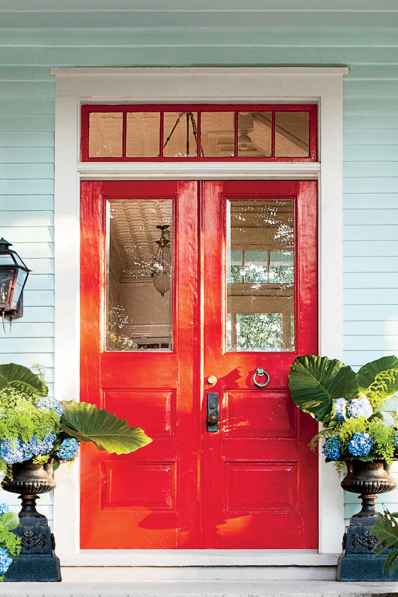 Red Front Door with Blue House