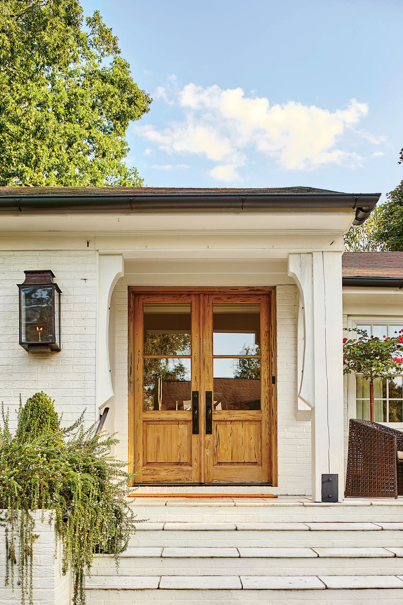 A dramatic ranch house renovation southern living for Double front doors for homes