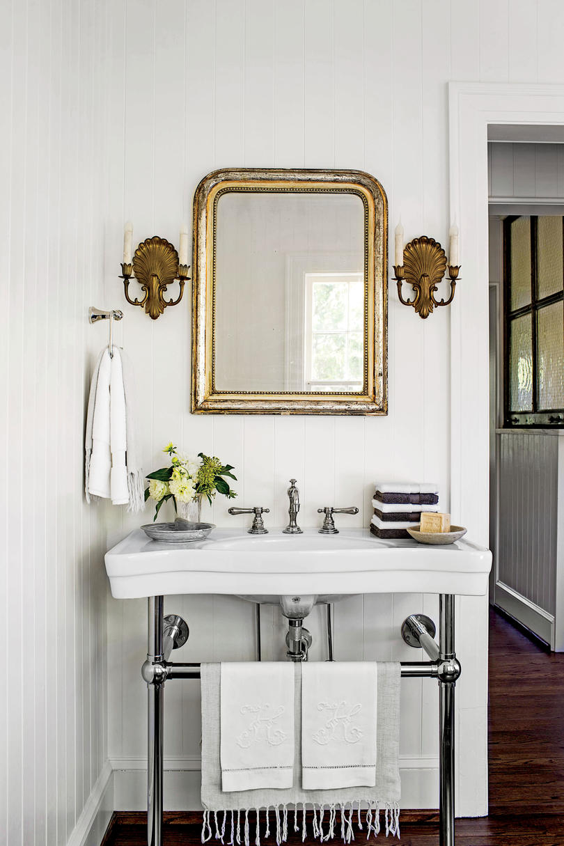 Gold Mirror in White Bathroom