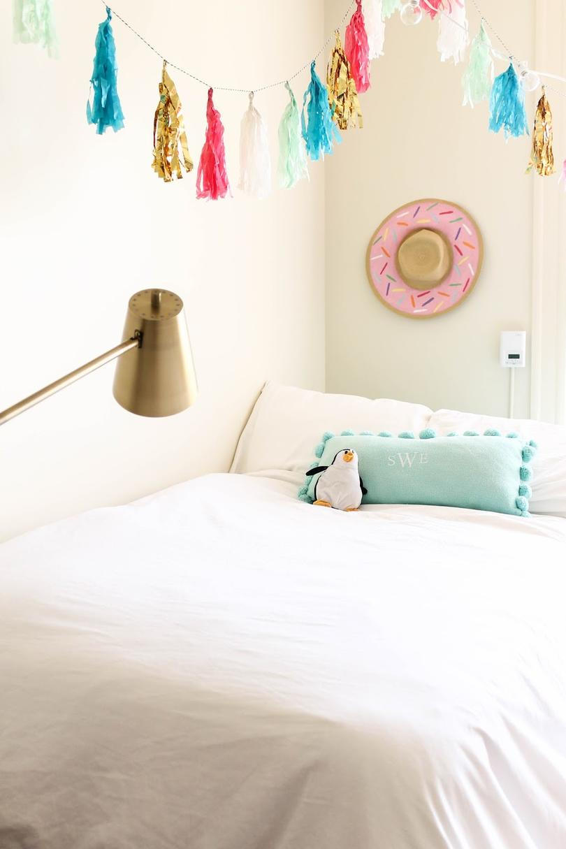 White Pink and Teal UT Austin Dorm Room