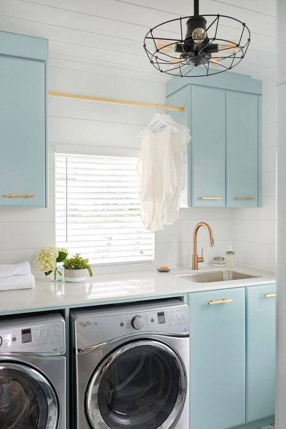 White Laundry Room With Light Blue Cabinets