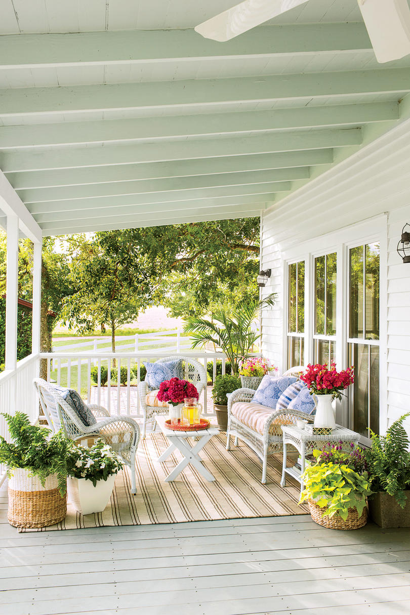 Surround Your Seating Area with Beautiful Blooms & 9 No-Fuss Floral Decorating Ideas For Your Front Porch - Southern Living