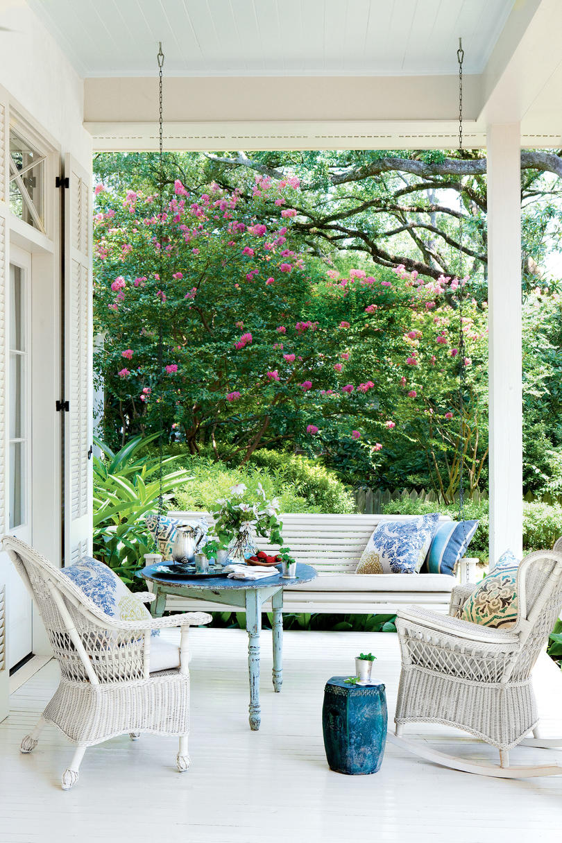 Blue And White Porch With Wicker Chairs Swing