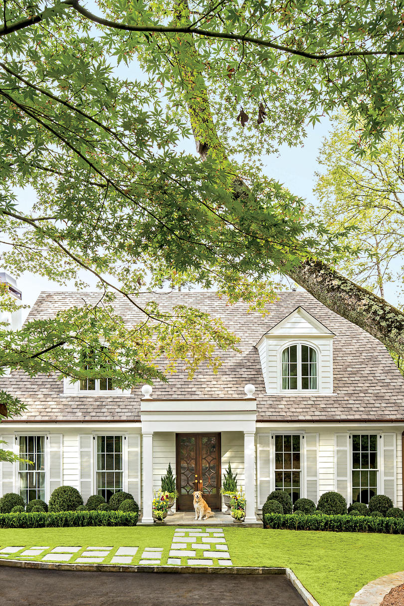 Curb Appeal with Green Hedges and Stone Path