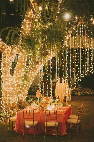12 ways to use your christmas lights in the summer southern living 12 ways to use your christmas lights in the summer outdoor wedding reception solutioingenieria Choice Image
