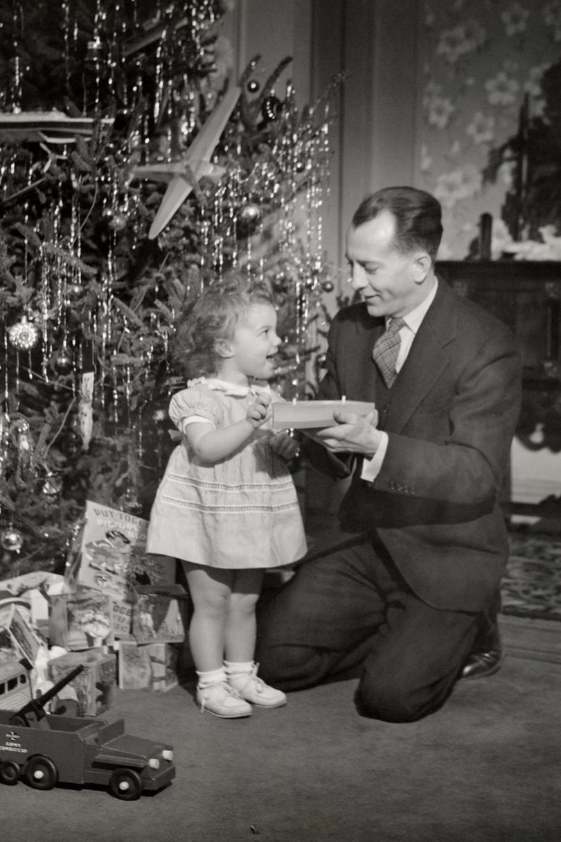 Father Giving Daughter Toy at Christmas