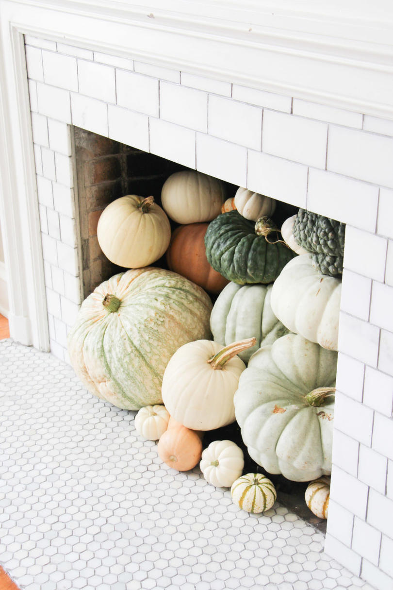 20 Incredible Ways to Decorate with Pumpkins This Fall Fill the Fireplace