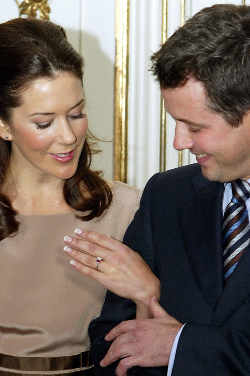 engagement finger ring an of on put rings photo royalty hand man up a the close bride