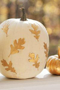 RX_1707_Ways to Decorate With Leaves This Fall_White Pumpkin with Gold Leaves