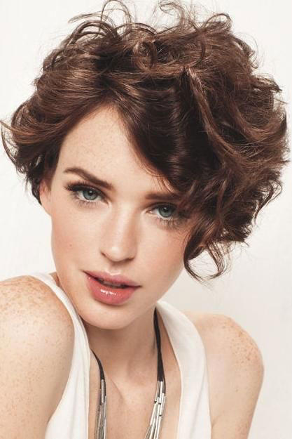 Curly pixie cuts were loving right now southern living asymmetrical solutioingenieria Gallery