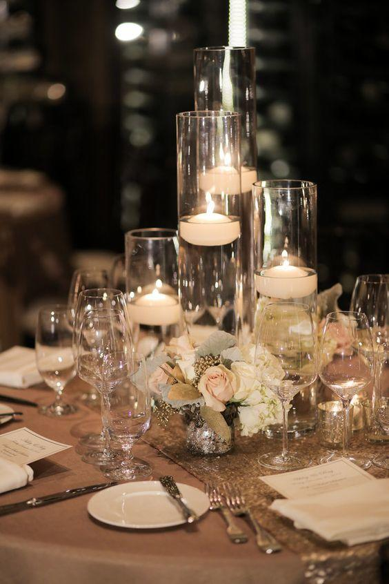 Beautiful centerpieces created with candles southern living - Glass vases for wedding table decorations ...