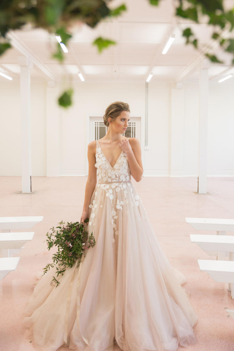 Blush wedding dress styles we love southern living strappy blush gown with floral embellishments junglespirit Image collections