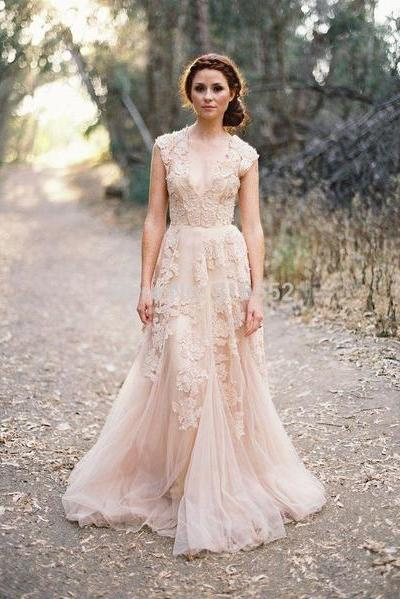 Blush wedding dress styles we love southern living boho lace and tulle gown junglespirit Image collections