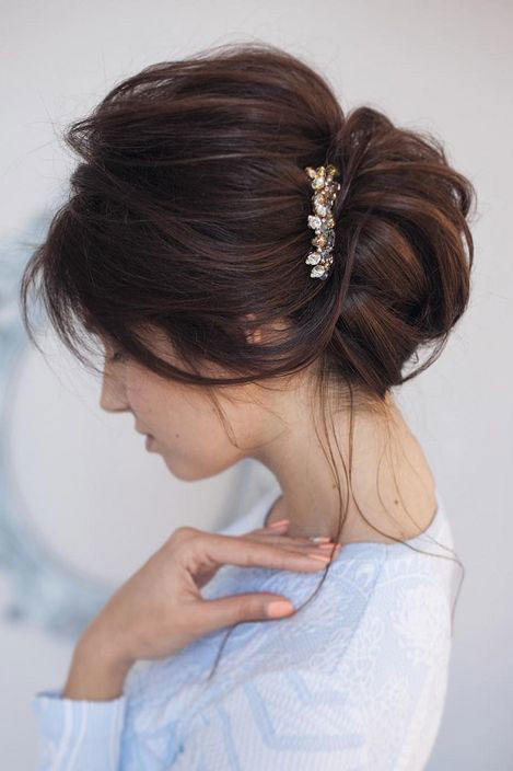 wearing hair up styles the history of bridesmaids why they all wear the same 4975 | volume chignon