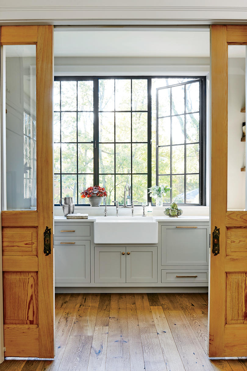 Sliding Doors into Gray Kitchen with Farmhouse Sink