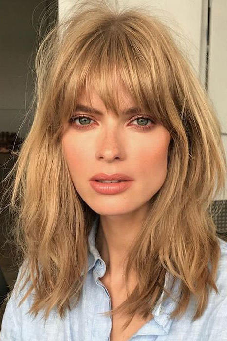 blunt haircuts for long hair fringe bangs are coming back and it looks on everyone 4866 | tousled fringe