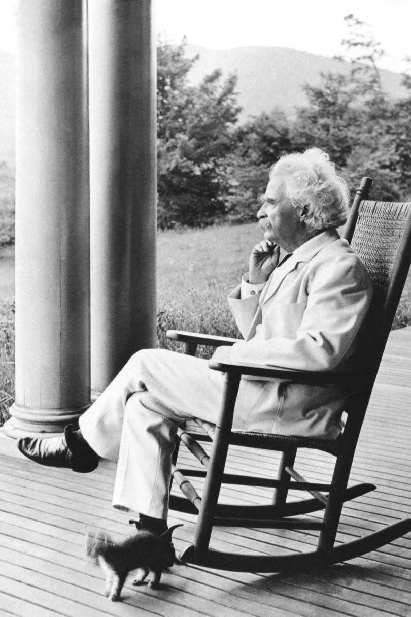 Mark Twain Sitting in Rocking Chair on Front Porch