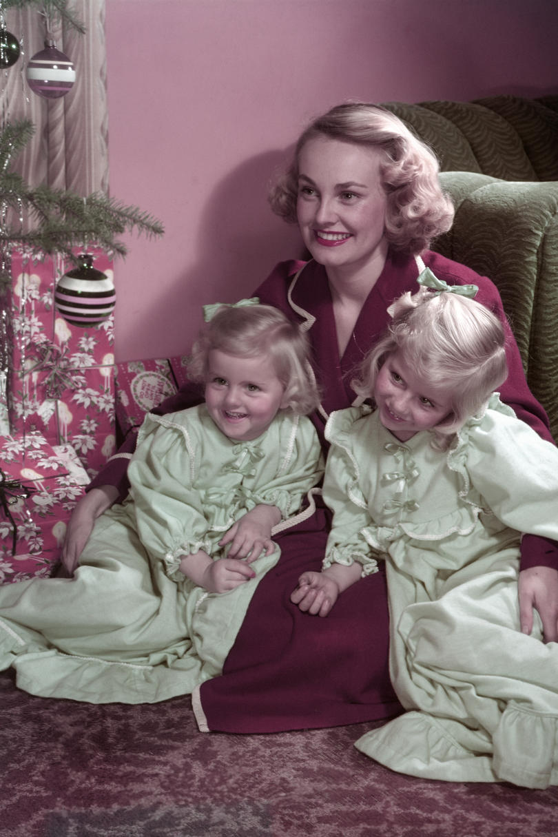 Woman with Daughters on Christmas Morning