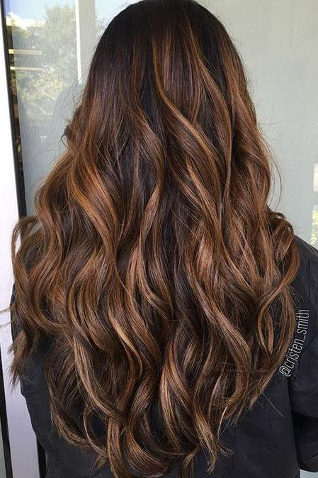 hair color styles for long hair hair color trends for 2018 southern living 4082 | cinnamon caramel swirl