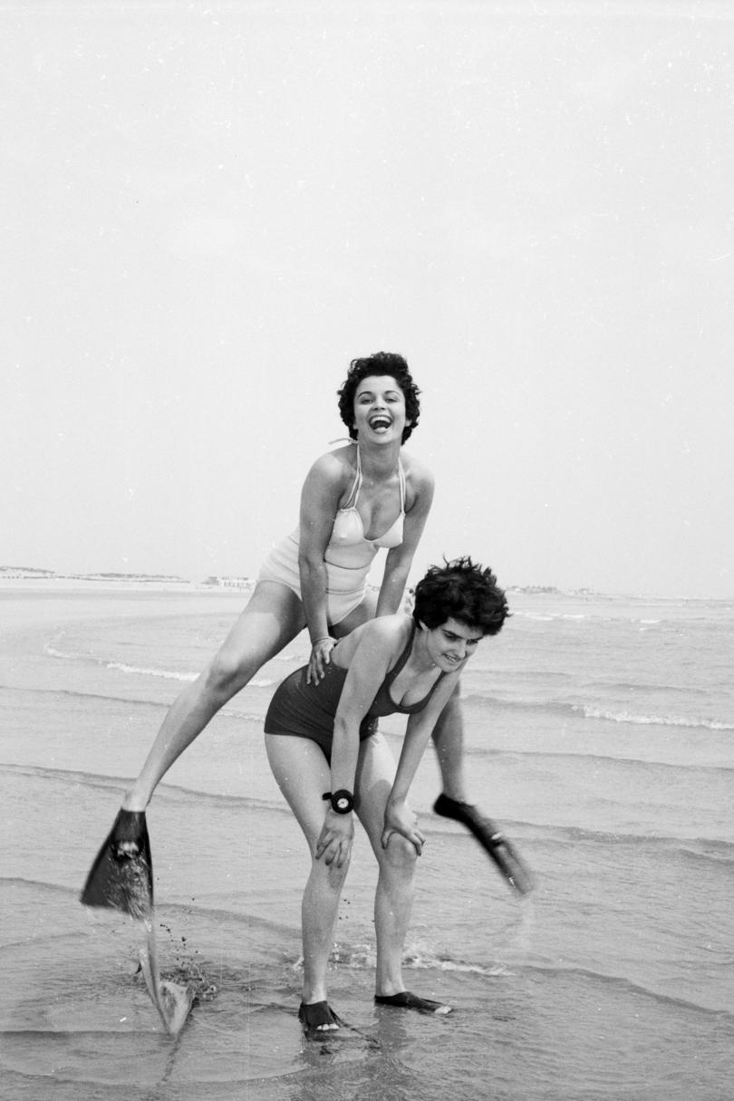 Women Playing Leap Frog at the Beach