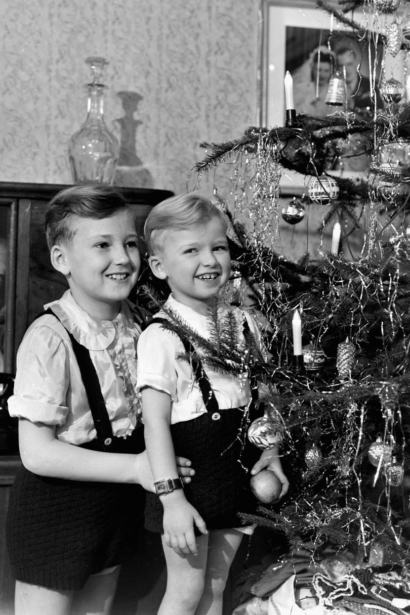 Boys Standing By Christmas Tree