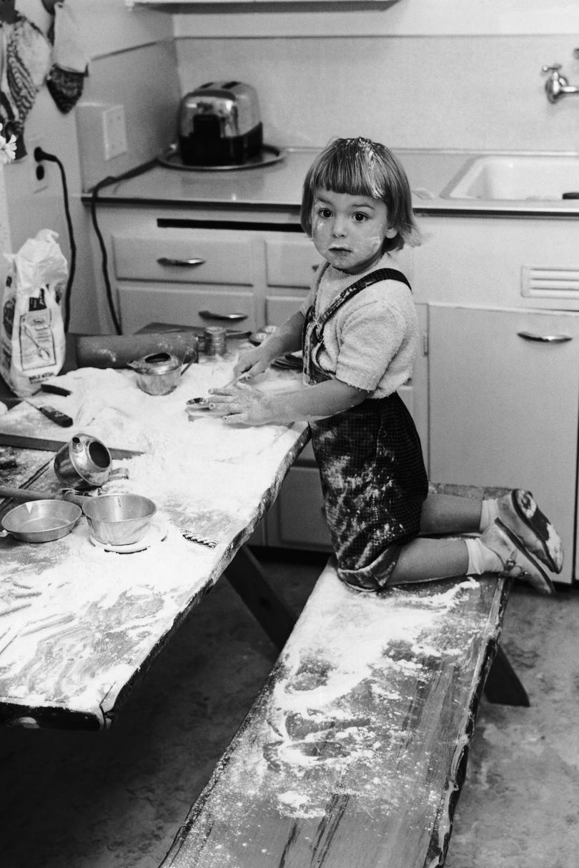 Baby playing in Flour
