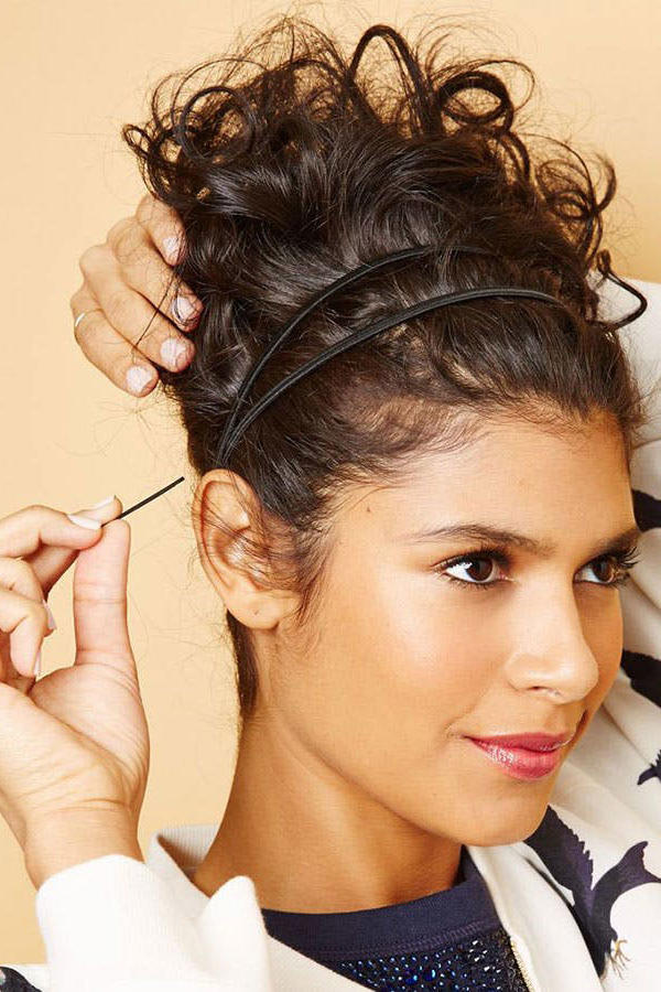 Messy Bun Hairstyles That ll Still Have You Looking Polished ... 25579ff7ad5