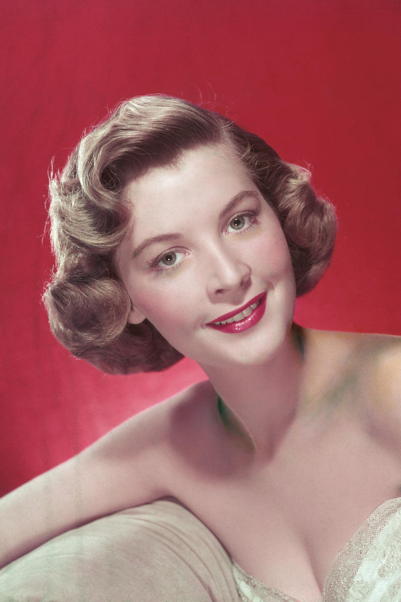 Woman in green dress with red lipstick